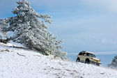 Off-road car on winter landscape — 图库照片