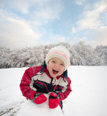 Happy little kid is playing in snow, good winter weather — Stock Photo