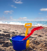 Children's beach toys on sand on a sunny day — Stock Photo