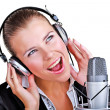 Singing woman in front of a microphone headset — Stock Photo