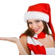 A beautiful woman dressed in a Christmas show at the open palm — Stock Photo #7307019