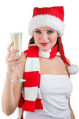 A woman dressed in a Christmas holding a glass of champagne — Stock Photo