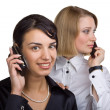 Two business women talking on mobile phone — Stock Photo #7398286