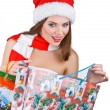 Pretty woman in Christmas dress opens with shopping bag — Stock Photo