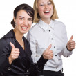 Two smiling business women show a thumbs up — Stock Photo