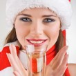 Close up woman dressed in a Christmas holding a glass of champagne — Stock Photo