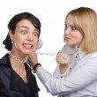 Business woman with telephone wire strangling another woman — Stock Photo