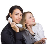 A woman overhears a phone conversation with another woman — Stock Photo