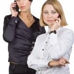 dos mujeres de negocios hablando por teléfono móvil — Foto de Stock