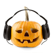 Round pumpkin with headphones — Stock Photo
