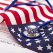 Stethoscope  on a USA flag - Stock Photo