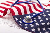Stethoscope on a USA flag — ストック写真