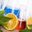 Stock Photo: Laboratory flask and orange