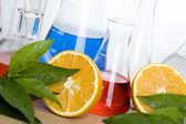 Laboratory flask and orange — Stock Photo