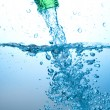Green bottle and water splashing — Stock Photo #7161465