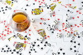 Cognac and playing card — Stock Photo