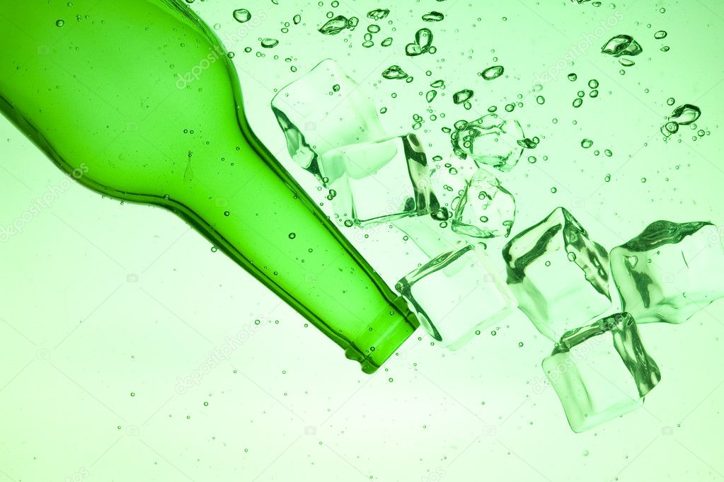 Green bottle with creative splashing green water  Stock Photo #7161053