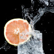 Fresh grapefruit and water — Stock Photo #7170050