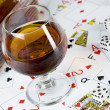 Cognac and playing card — Stock Photo #7173289