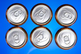 Shiny soda.beer cans viewed from above — Stock Photo