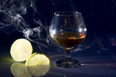 Cognac with lime — Stock Photo