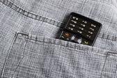 Teléfono en el bolsillo — Foto de Stock