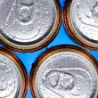 Stock Photo: Shiny soda, beer cans viewed from above