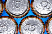 Shiny soda, beer cans viewed from above — Stock Photo