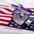 Stethoscope and globe on a USA flag - Stock Photo