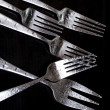Fork on the black background — Stock Photo #7254615