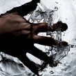 Hand on black water — Stock Photo #7262648