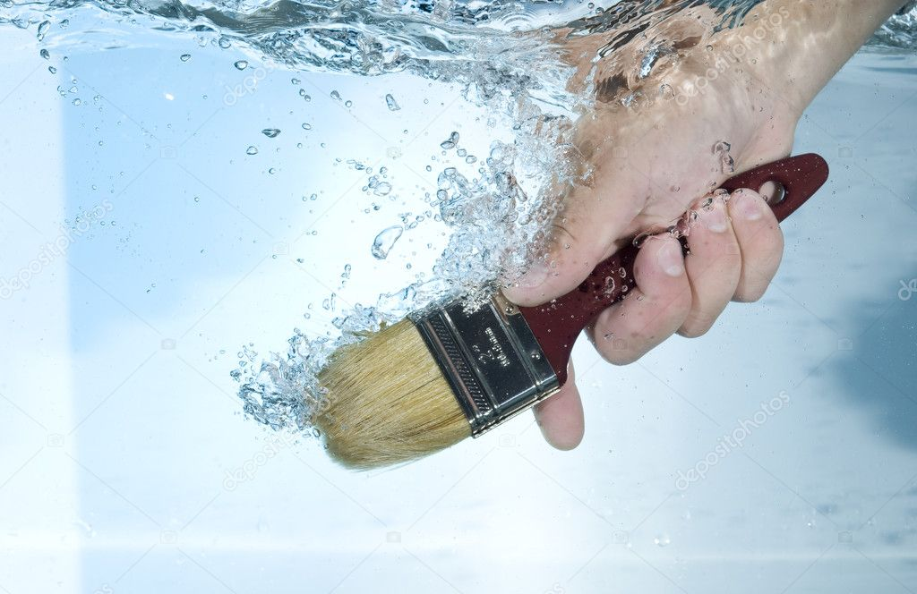 Hand with brush in water  Stock Photo #7264792