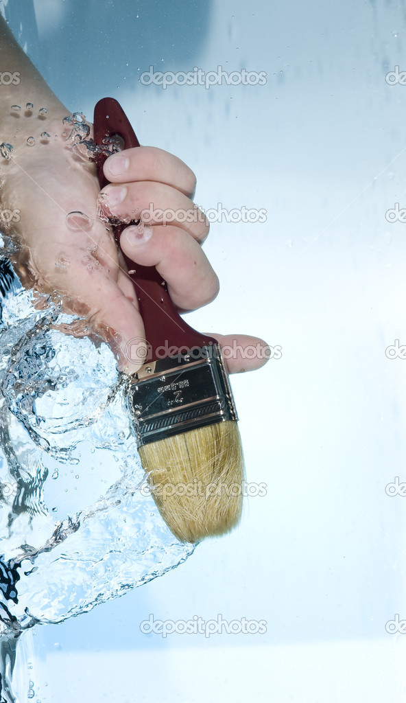 Hand with brush in water — Stock Photo #7264861