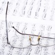 Note pad and glasses — Stock Photo