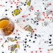 Cognac and playing card - Stock Photo
