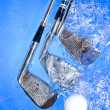 Golf club in blue water — Stock Photo #7271342