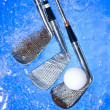Golf club in blue water — Stock Photo