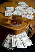 Dollar and whisky — Stock Photo