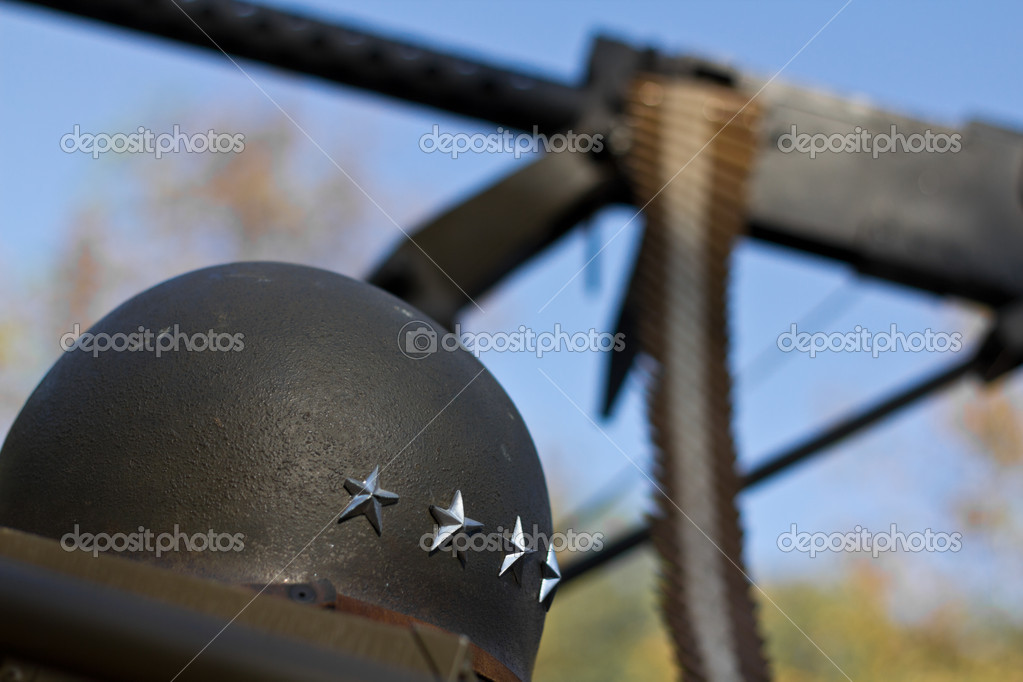 US army helmet in front of a machine gun, WW2 era. — Stock Photo #7326308