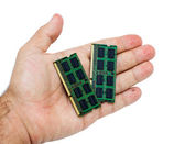 Hand with laptop memory modules — Stock Photo