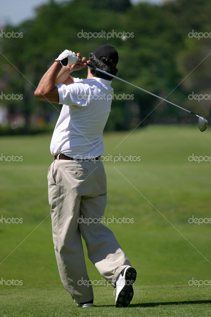 Player hitting a golf ball  Stock Photo #7251453
