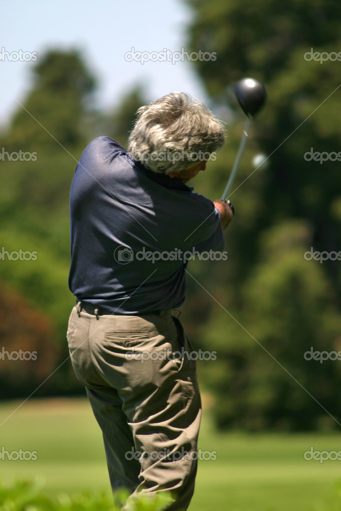 Player hitting a golf ball  Stock Photo #7251588