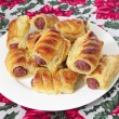 A plate of sausage rolls, traditional British Christmas food — Stock Photo