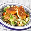 Fattoush with fried haloumi - Stock Photo