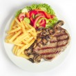 Steak and fries with salad — Stock Photo