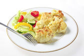 Cauliflower cheese and salad with fork — Stock Photo
