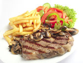 Steak chips and mushrooms — Stock Photo