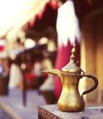 Qatari coffee pot welcome — Stock Photo