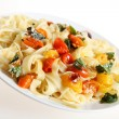 Tagliatelle and tomatoes slanted — Stock Photo