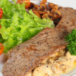Stock Photo: Veal with mushrooms in cream sauce vertical
